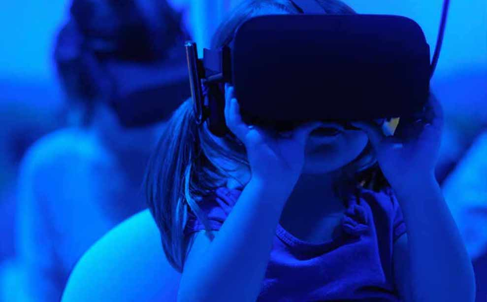 A girl using a VR headset.